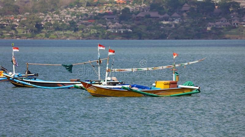 Beautiful picture of fishing boats at Jimbaran Bay at Bali Indonesia, beach, ocean, fishing boats and airport in photo. Wide panoramic picture of Jimbaran Bay stock images