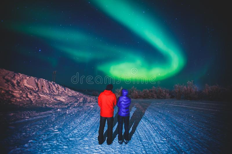 Beautiful picture of massive multicolored green vibrant Aurora Borealis, also known as Northern Lights, Sweden, Lapland stock photo