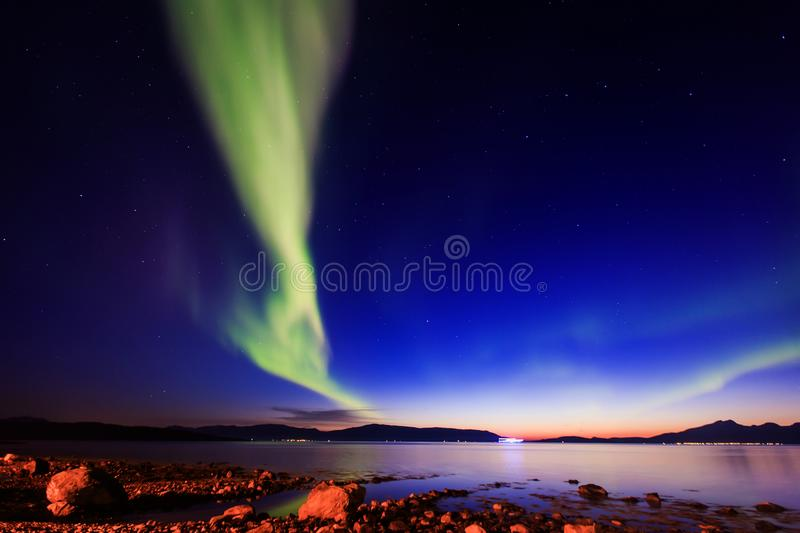 Beautiful picture of massive multicolored green vibrant Aurora Borealis, Aurora Polaris, also know as Northern Lights in Norway royalty free stock photo