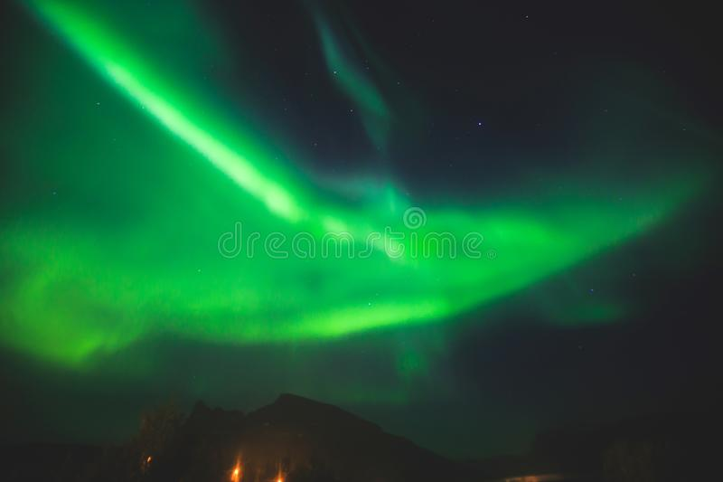 Beautiful picture of massive multicolored green vibrant Aurora Borealis, Aurora Polaris, also know as Northern Lights in Norway royalty free stock image