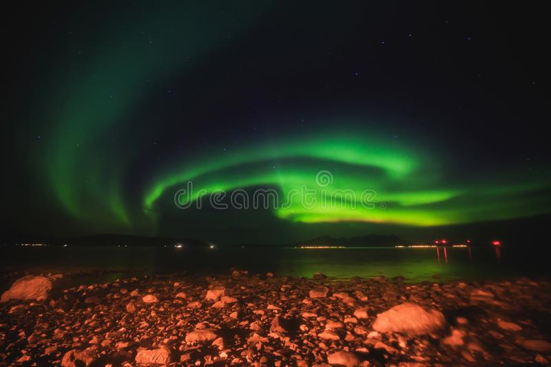 Beautiful picture of massive multicolored green vibrant Aurora Borealis, Aurora Polaris, also know as Northern Lights in Norway royalty free stock images