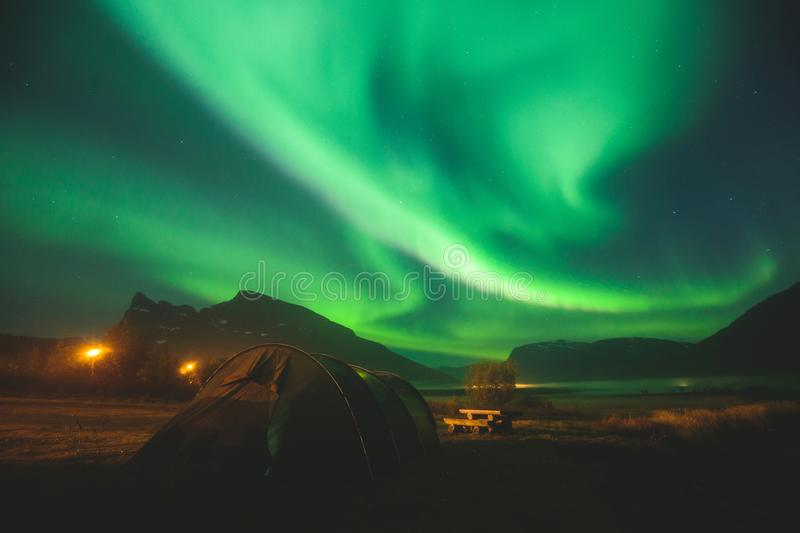Beautiful picture of massive multicolored green vibrant Aurora Borealis, Aurora Polaris, also know as Northern Lights in Norway stock photos