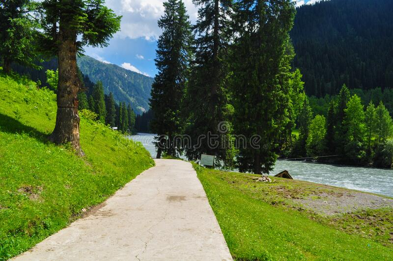 Mountains, forests and lake in Azad jammu and kashmir. Beautiful picture of mountains, forests and lake during daytime in Azad jammu and kashmir, Pakistan stock images