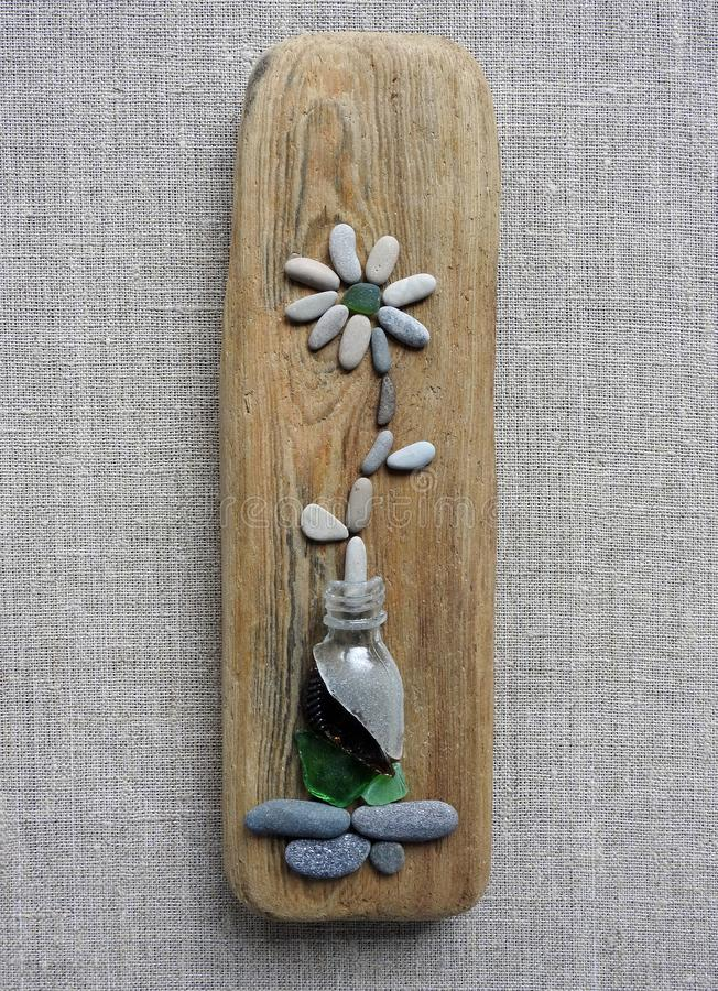 Wooden piece with stones flower, Lithuania royalty free stock images