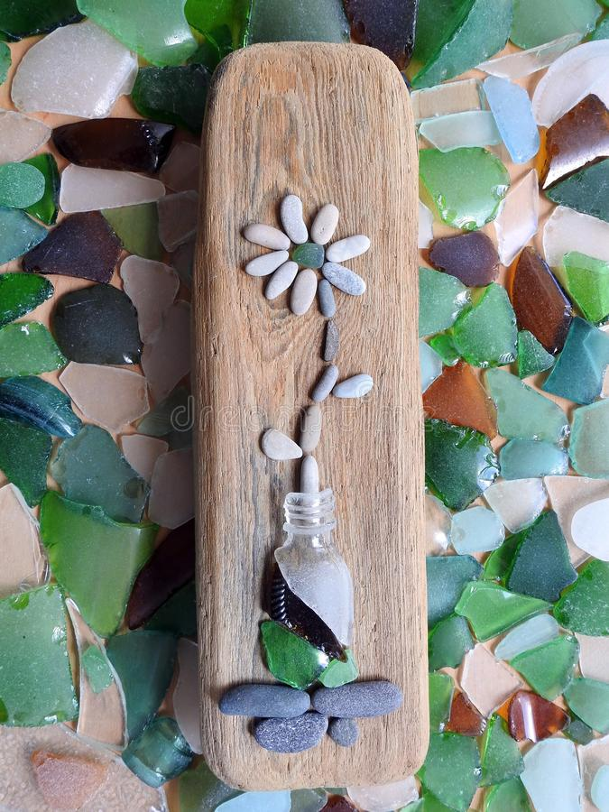 Wooden piece with stones flower, Lithuania royalty free stock photo