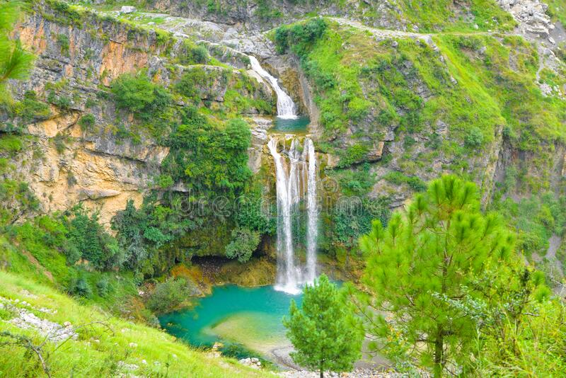 Waterfall and trees in Azad jammu and kashmir. Beautiful picture of Waterfall and trees during daytime in Azad jammu and kashmir, Pakistan stock photos