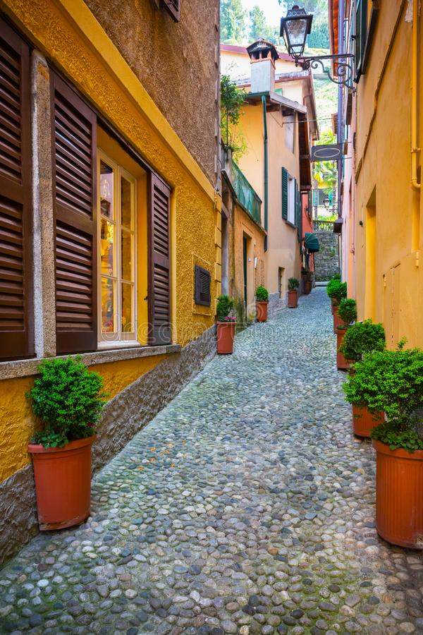 Old town street in Bellagio, Como lake, Italy. Beautiful picturesque old town street in Bellagio, Como lake, Italy royalty free stock photography