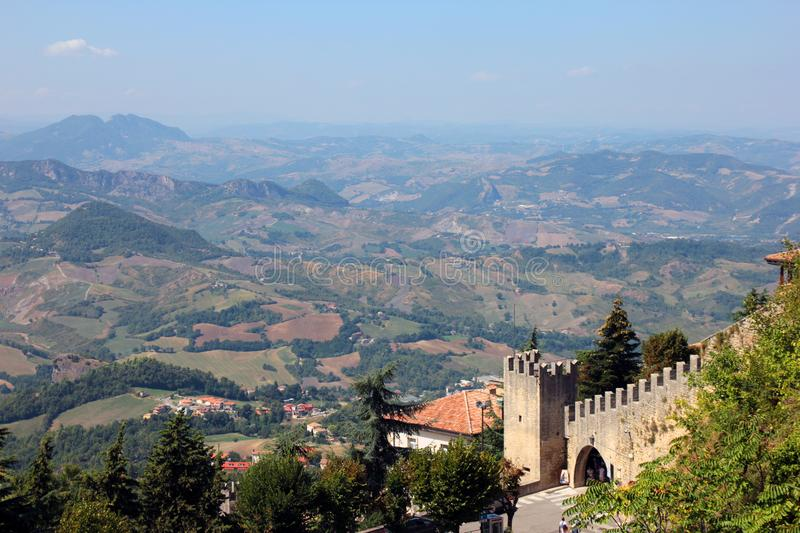 Beautiful picturesque panoramic views of San Marino hills and old medieval stone castle wall with battlements royalty free stock photos