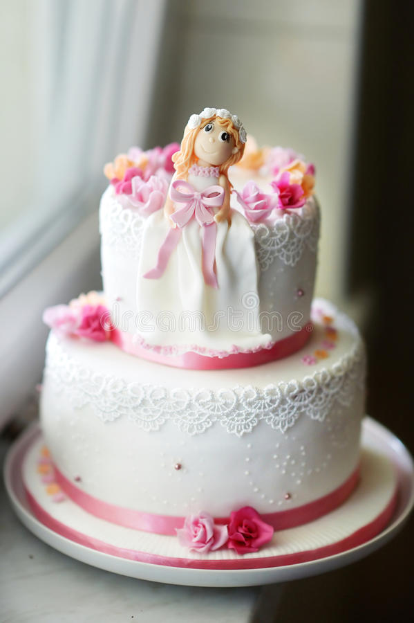 Beautiful pink birthday cake. With little doll figurine on top royalty free stock photos