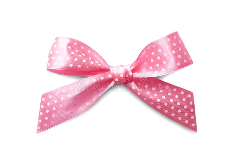 Beautiful pink bow with polka dot pattern. On white background royalty free stock photography