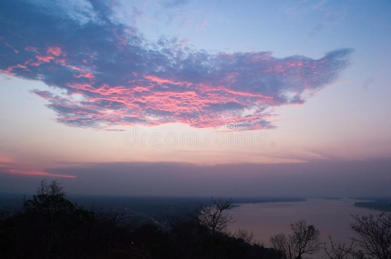 Beautiful pink clouds on a sunset. Above the Mekong River near Pakse, Laos royalty free stock images