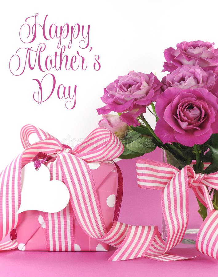 Beautiful pink gift and roses on pink and white background with sample text and copy space for your text here for Mothers Day royalty free stock photo