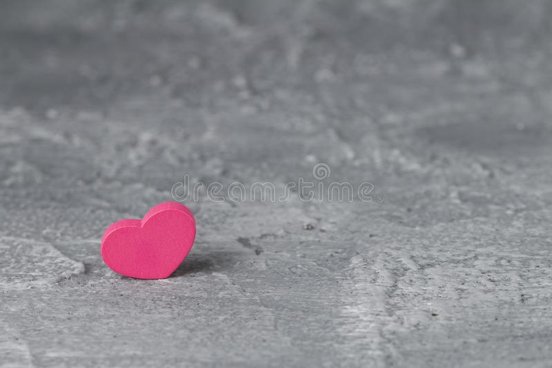 Beautiful pink heart and concrete background. Love symbol and copy space, Valentines Day background.  royalty free stock photo