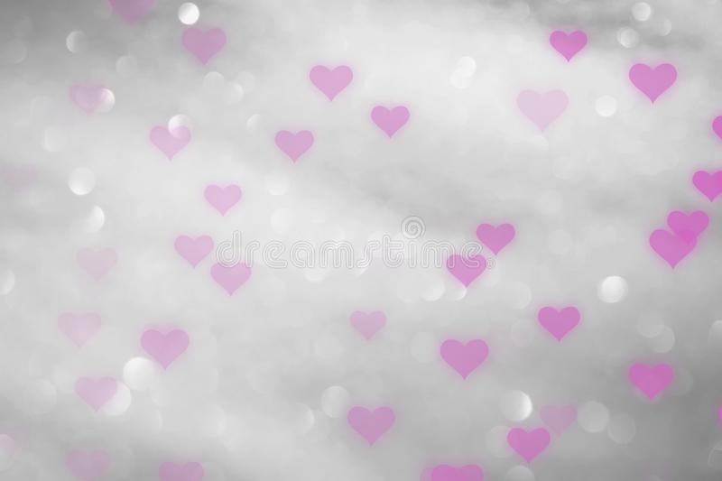 Beautiful pink hearts on silver bokeh background royalty free stock image