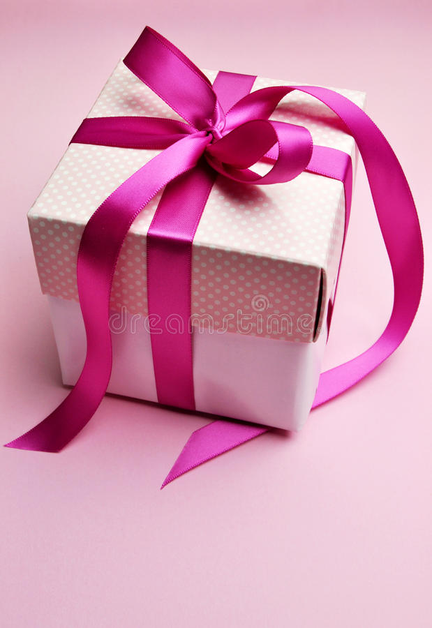 Beautiful pink present gift in white box and polka dot lid. stock image