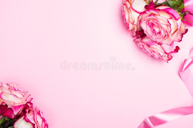 Beautiful pink rose, decorative confetti hearts and pink ribbon on pink Valentines day background royalty free stock photos