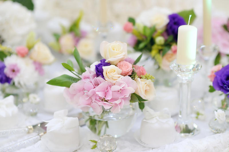 Beautiful pink roses in small vases stock photography
