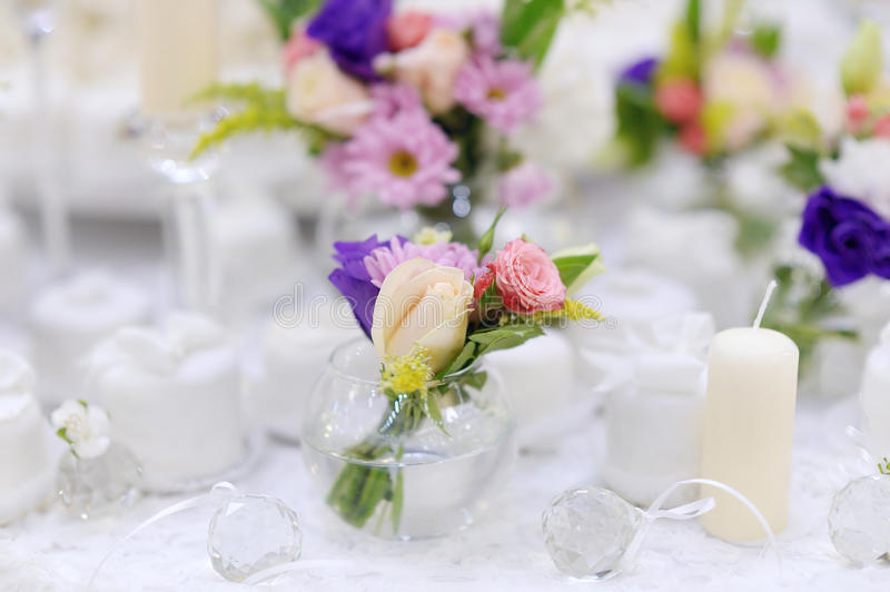 Beautiful pink roses in small vases royalty free stock photos