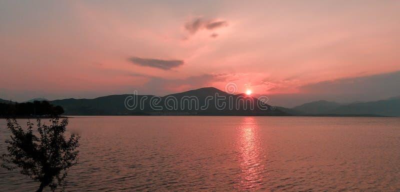 Beautiful pink sunset at Lake with mountain stock photo