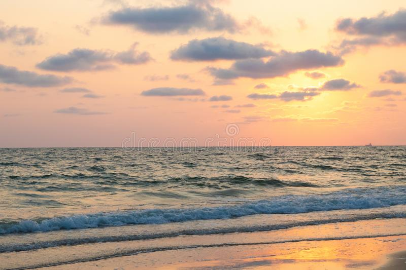 Beautiful pink sunset over sea, background royalty free stock image