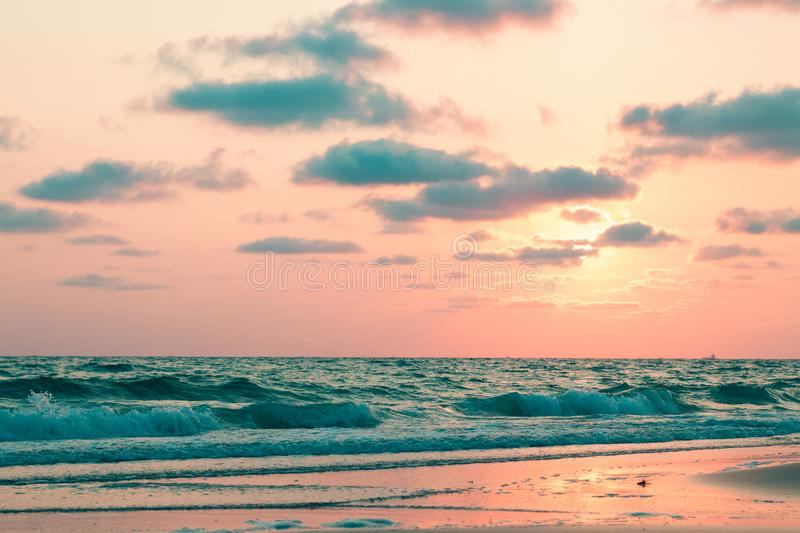 Beautiful pink sunset over sea, background stock photography