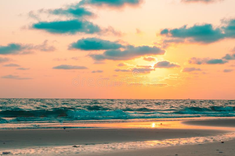 Beautiful pink sunset over sea, background royalty free stock images