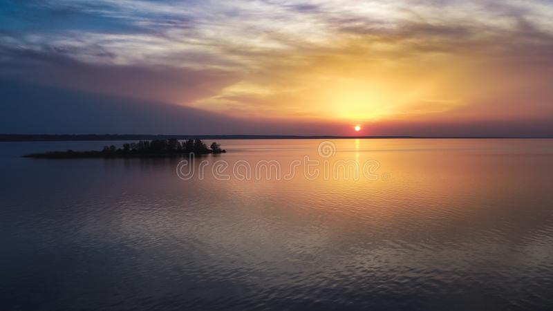 Beautiful pink sunset with sun rays over sea. royalty free stock photography