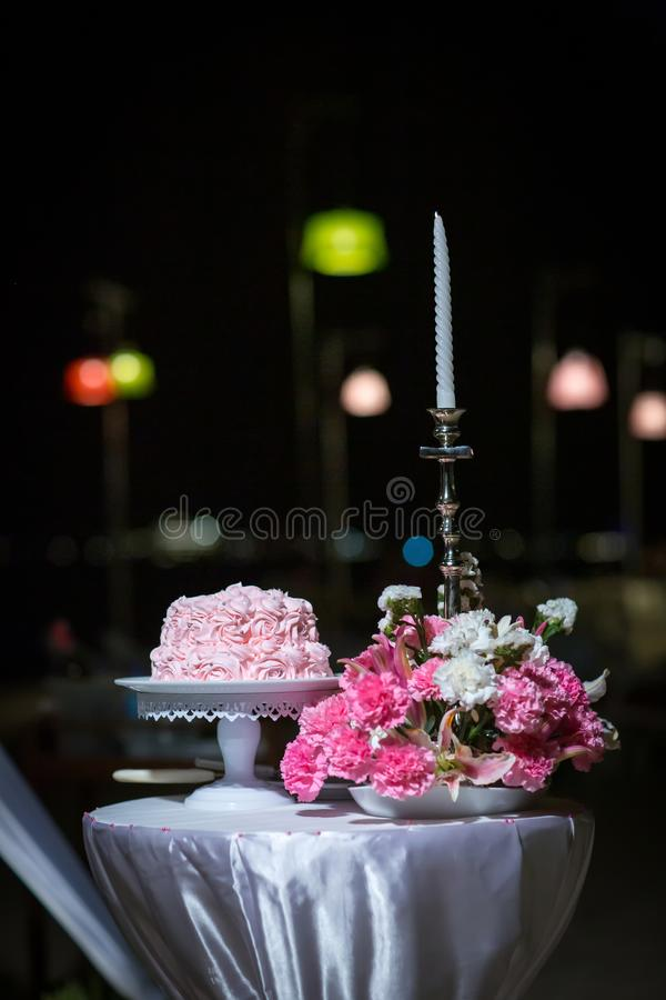 Beautiful pink wedding cake. white vintage wedding cake on wooden table stock photo