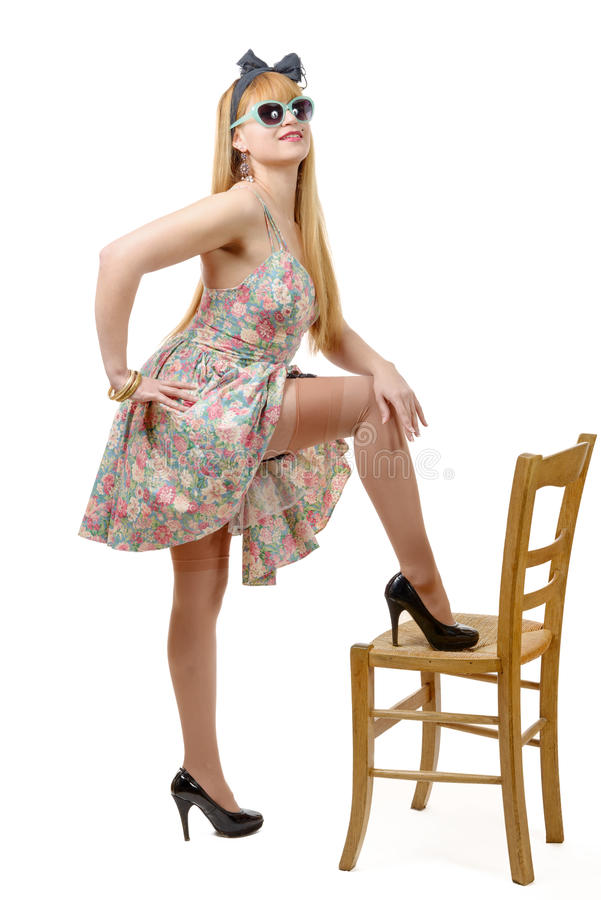 Beautiful pinup girl with a colorful dress stock photo