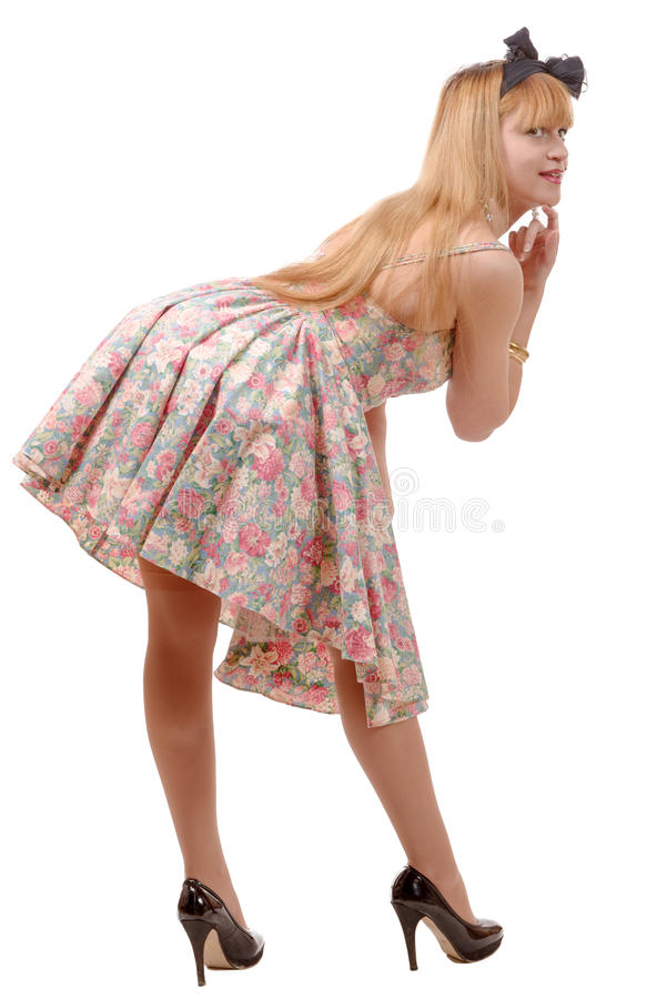 Beautiful pinup girl with a colorful dress royalty free stock photography