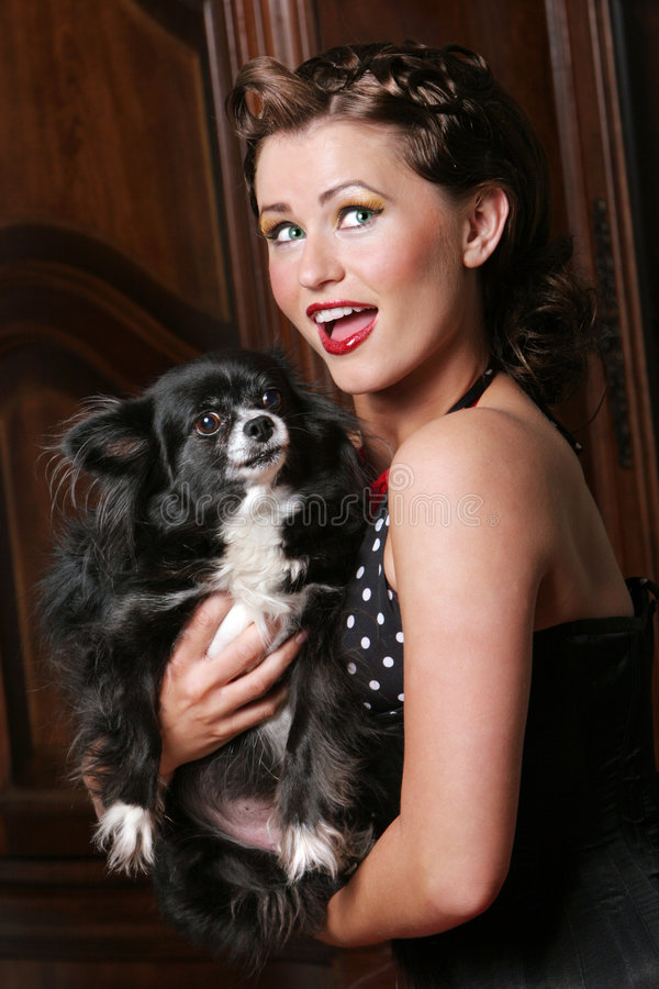 Beautiful Pinup Girl And Puppy Royalty Free Stock Image