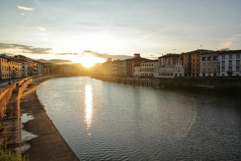 Beautiful Pisa city in the early morning with sunrise, colorful houses and river. This scene is taken at beautiful and peaceful Pisa city. City in the early royalty free stock photography