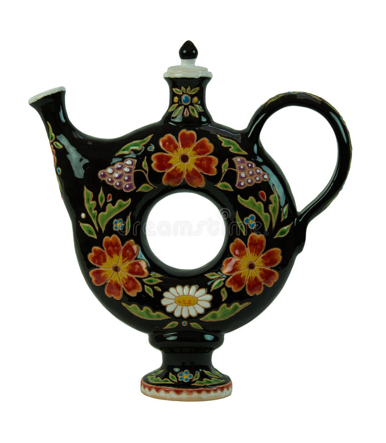 Beautiful pitcher for beverages in the form of a torus isolated. Pitcher for beverages in the form of a torus - pottery handmade from clay. Pitcher black stock photography