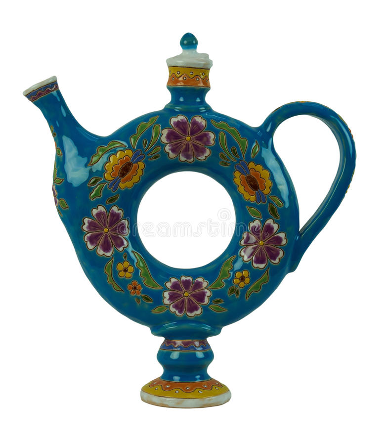 Beautiful pitcher for beverages in the form of a torus isolated. Pitcher for beverages in the form of a torus - pottery handmade from clay. Pitcher blue, painted royalty free stock images