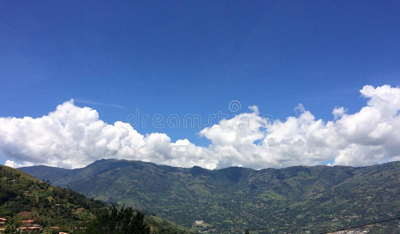Landscape of mountains embraced by a beautiful sky. A beautiful place is seen, natural and without contamination. Surrounded by beautiful mountains and mountains royalty free stock photos