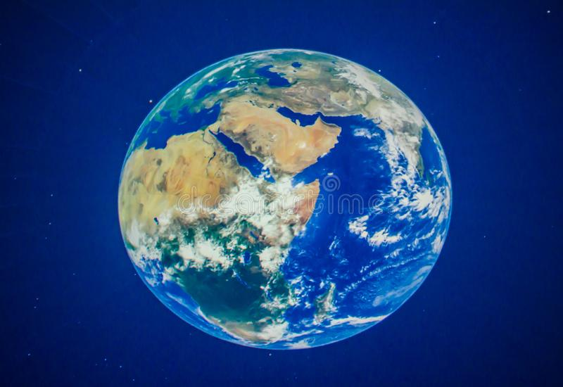 Beautiful planet earth at planetarium. A Beautiful planet earth at planetarium, a theatre built primarily for presenting educational and entertaining shows royalty free illustration