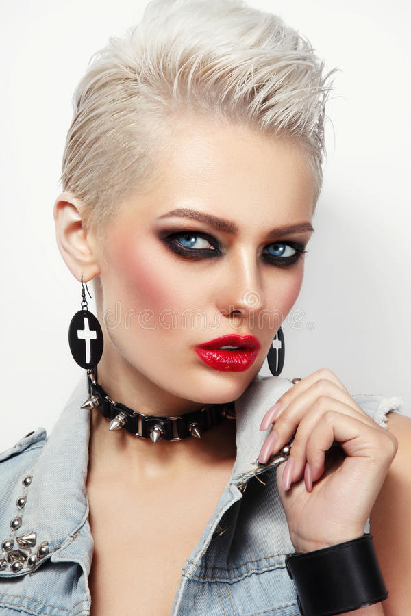 Beautiful platinum blond woman with 80s style makeup stock photo