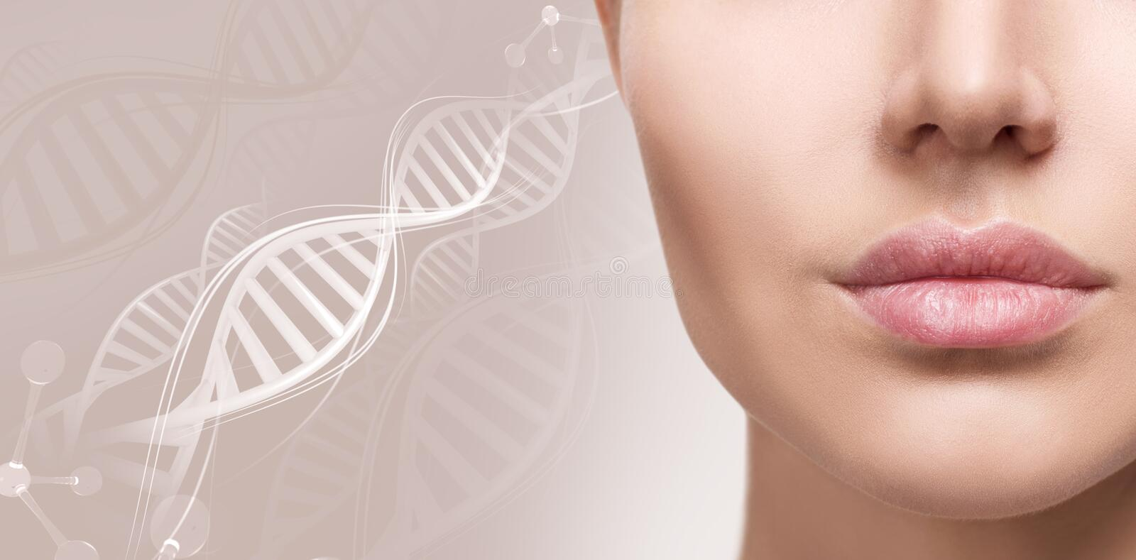 Beautiful plump female lips among DNA chains. Beautiful plump female lips among DNA chains over beige background royalty free stock photo