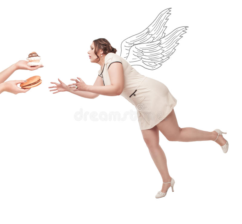 Beautiful plus size woman flying for junk food. Beautiful brunette plus size woman flying for junk food isolated stock photos