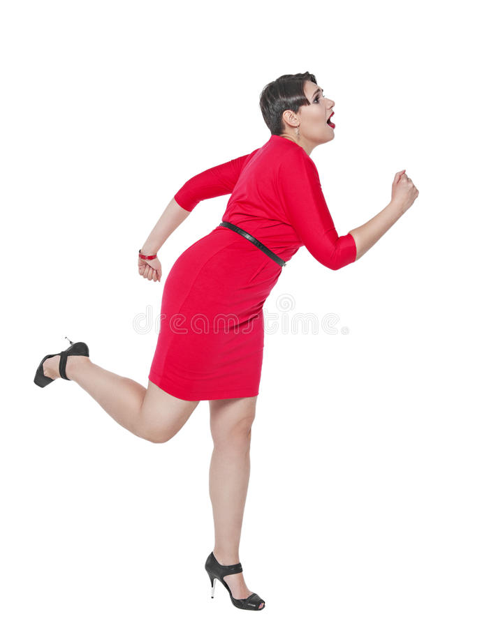 Beautiful plus size woman run away from something isolated. On white background royalty free stock images
