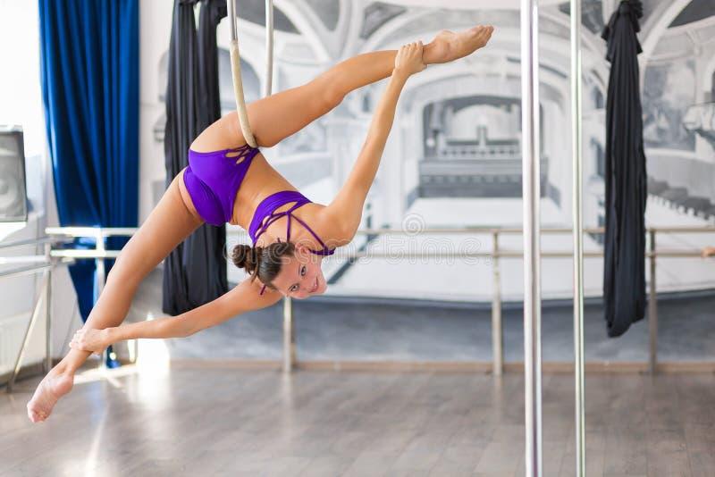 Beautiful pole dancer. In the dance studio royalty free stock photos