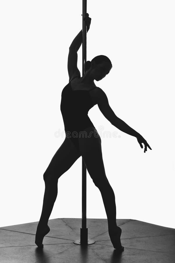 Beautiful pole dancer girl silhouette royalty free stock photos