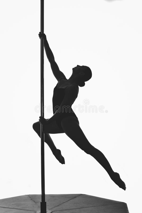 Beautiful pole dancer girl silhouette royalty free stock image