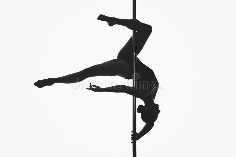Beautiful pole dancer girl silhouette royalty free stock photos