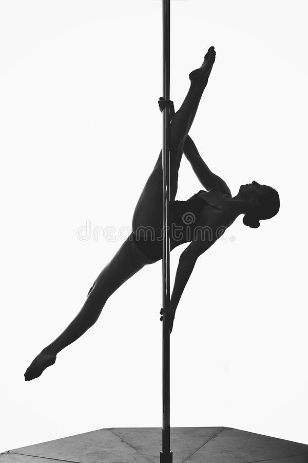 Beautiful pole dancer girl silhouette royalty free stock photography