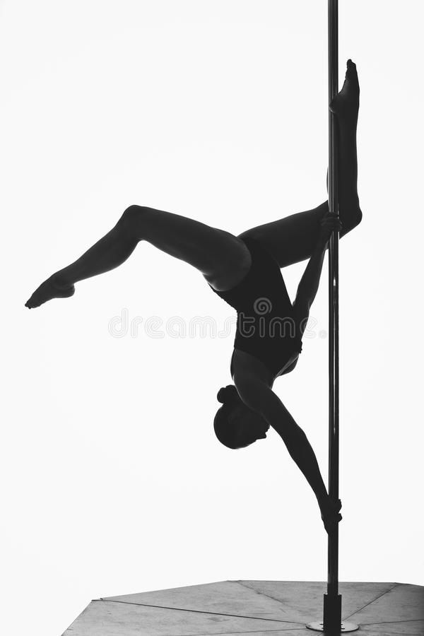 Beautiful pole dancer girl silhouette royalty free stock photo