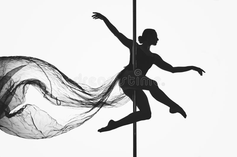Beautiful pole dancer girl silhouette stock photography