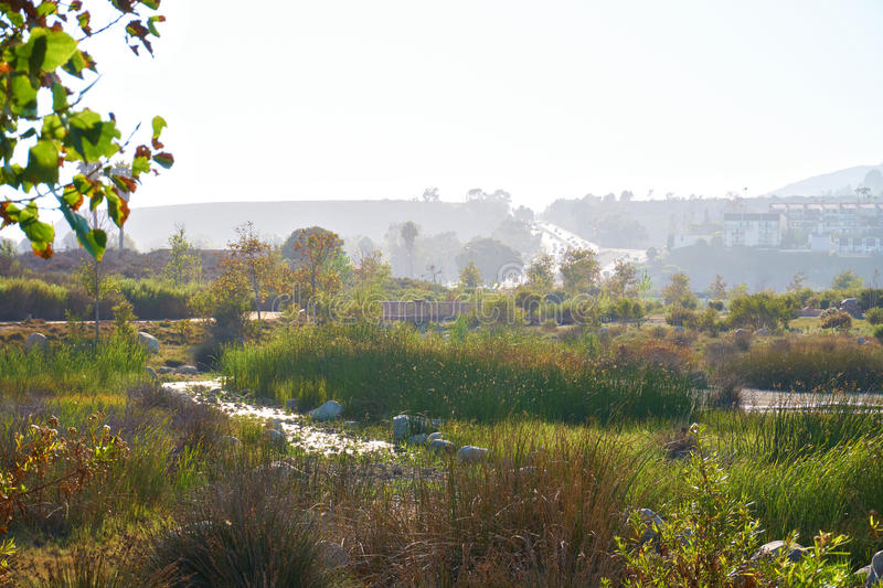 Beautiful pond in Malibu at sunset. The hills in the background royalty free stock image