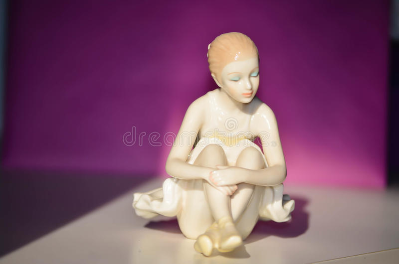 Beautiful Porcelain Figure of a Pretty Young Lady Ballet Dancer. Beautiful Porcelain Figure of a Pretty Young Lady Ballet Dancer siting on the floor and resting stock photos