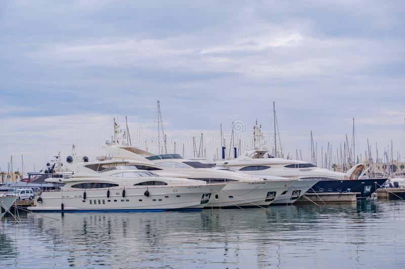 Beautiful port of Alicante, Spain Luxury yachts, ships, fishing boats sailing and standing in rows in harbor royalty free stock photos